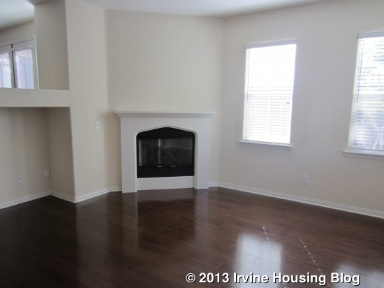 The Dark Hardwood Floors Offer A Nice Contrast To White Fireplace And Light Colored Walls