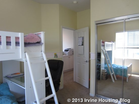 Unique The master bedroom also faces the street It us a good sized room for a condo and has a tiny balcony at the front There is a walk in closet and carpet that