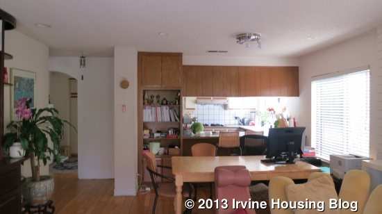 View From Sliding Glass Door Looking Into Family Room Kitchen Built Ins Are Along The Left