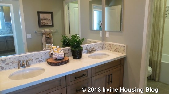 All Of The Bathrooms Have Solid Surface E Stone Countertops Laundry Room Which Contains A Sink Counter And Cabinets Separate Two Bedrooms