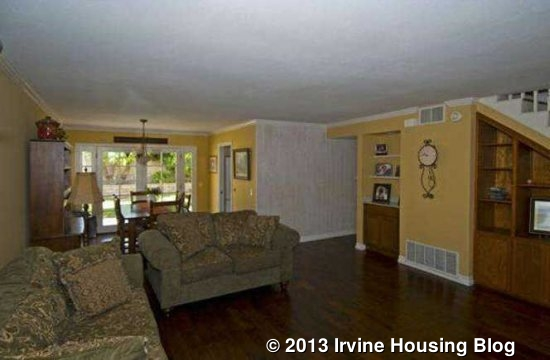 The Living Room Has Built In Bookshelves And Cabinets Under Staircase A Good Sized Dining Table Can Be Accommodated Area